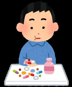精神を安定させる薬を飲む人